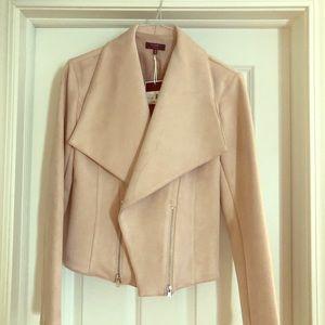 Women's light pink jacket w/zipper accents. Sz M